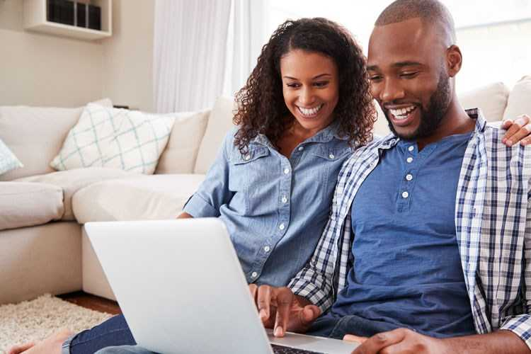 Couple looking online at homes